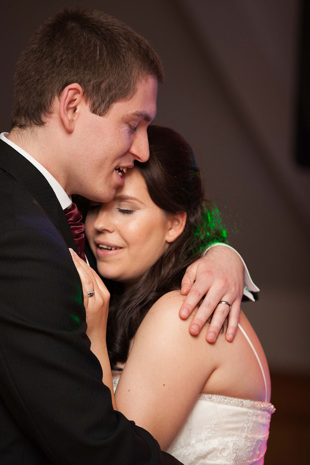 groom-holding-his-bride-during-the-first-dance.jpg