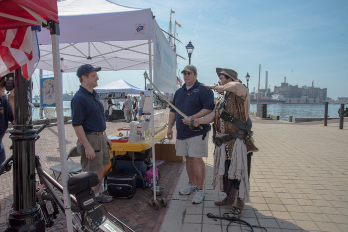 While peacefully sharing stories and info with passersby these volunteers were ambushed by a rogue privateer.