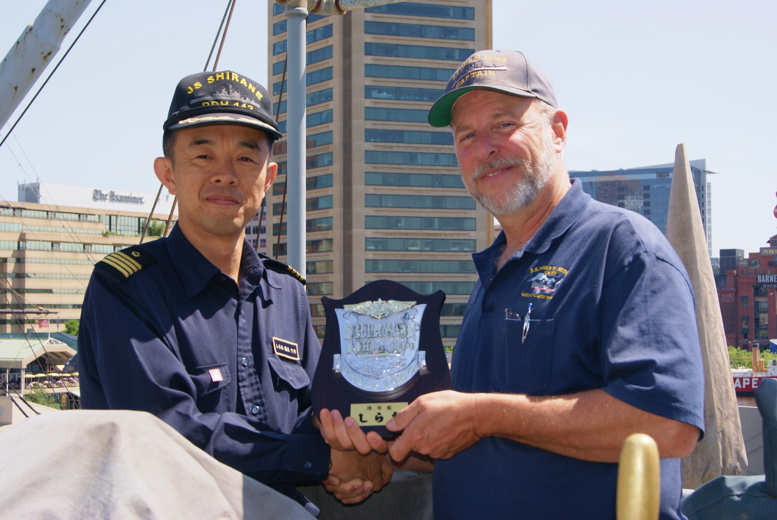 The Captain from the  JS SHIRANE  who along with his officers came for the short ride from Clinton Street to the Inner Harbor for the 2012 portion of Sailabration.  Below they are visiting the flying bridge.   JDS SHIRANE (DDG-143)   is a   destroyer   in the  Japan Maritime Self-Defense Force.