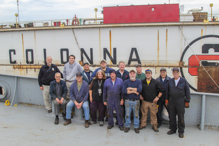 A group shot of the majority of those that came and spent time aboardwhile we were at dry dock.  Taken the morning of departure from  Colonna's Shipyard  .    Back left to right : Rick, Fred, John, Zack, Barney, Duff, Nic.   Front left to right : Mike, Walt, Andrea, Fran, Joe, Liam, and Greg.   Missing  Howard D., Joe C., and Paul J. in this shot.