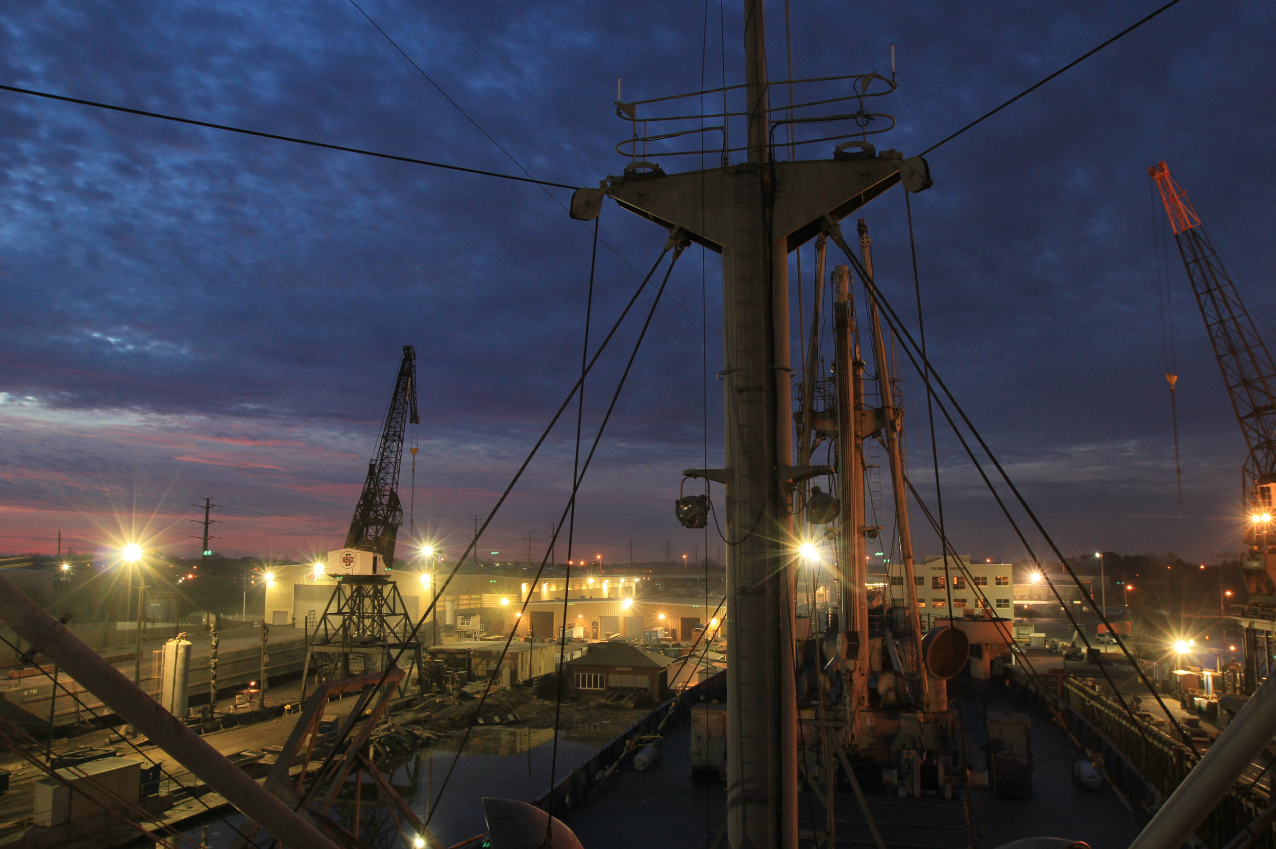 Taken on 12/6/14, on the morning that we are leaving the shipyard to return to Baltimore.  It was a verycloudy sky and it was debatable if we would see the sun, but goodbyes to the Norfolk/Portsmouth skies and the shipyard needed to be made by the photographer and theBROWN on our last day at  Colonna's Shipyard.