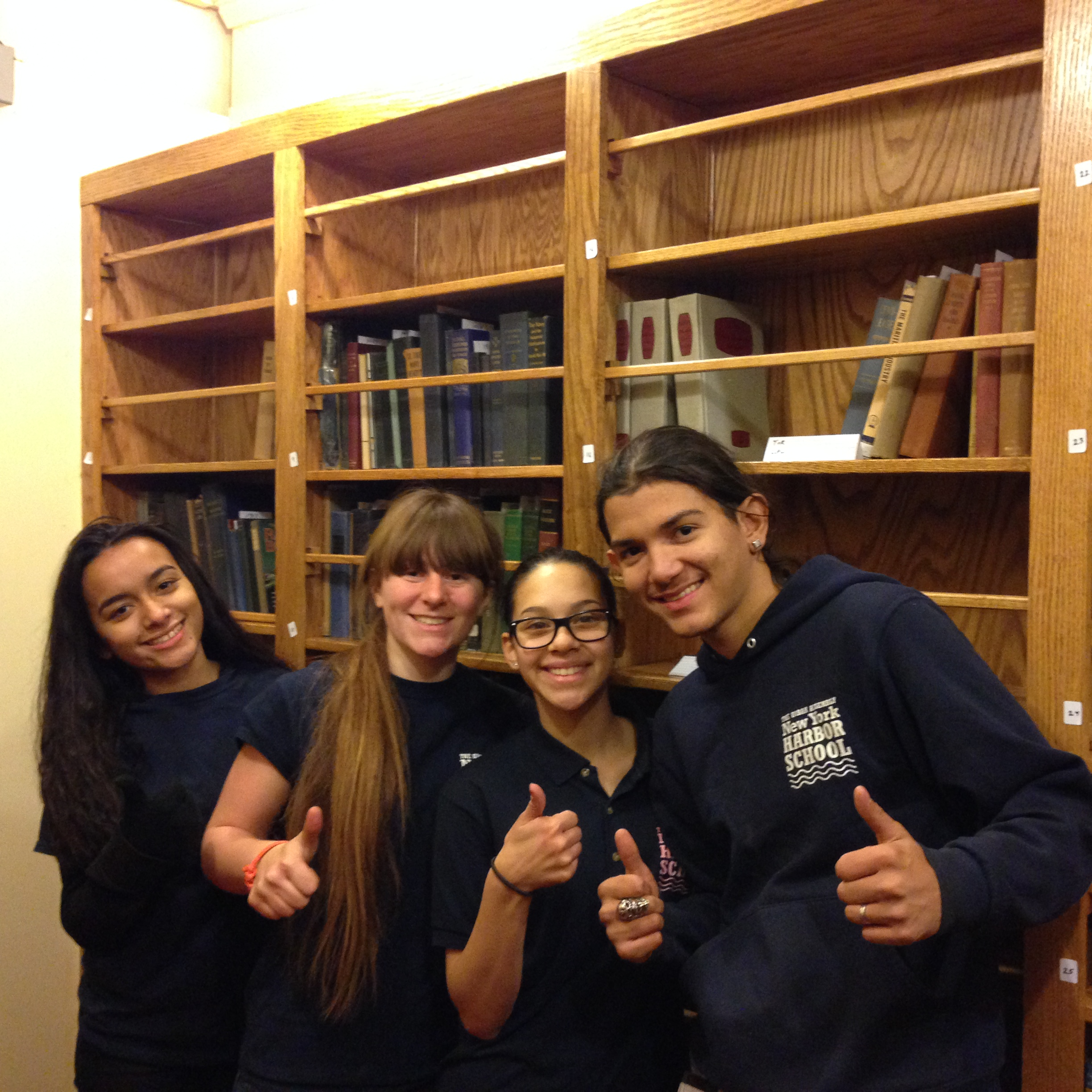 Students pose for a shot in the library after unloading dozens of boxes of books and old uniforms from the library annex. They also got to enjoy the opportunity to look through historical items in the annex, including a complete collection of LIFE magazines from as far back as 1938, training manuals and history books from the 1940's, and even a complete set of flash cards from the BROWN's School Ship years.  Photographs and wartime propaganda posters were a big hit, allowing the students to see how marketing has changed over the last eight decades, and get a glimpse of what life was like before and during the war years.