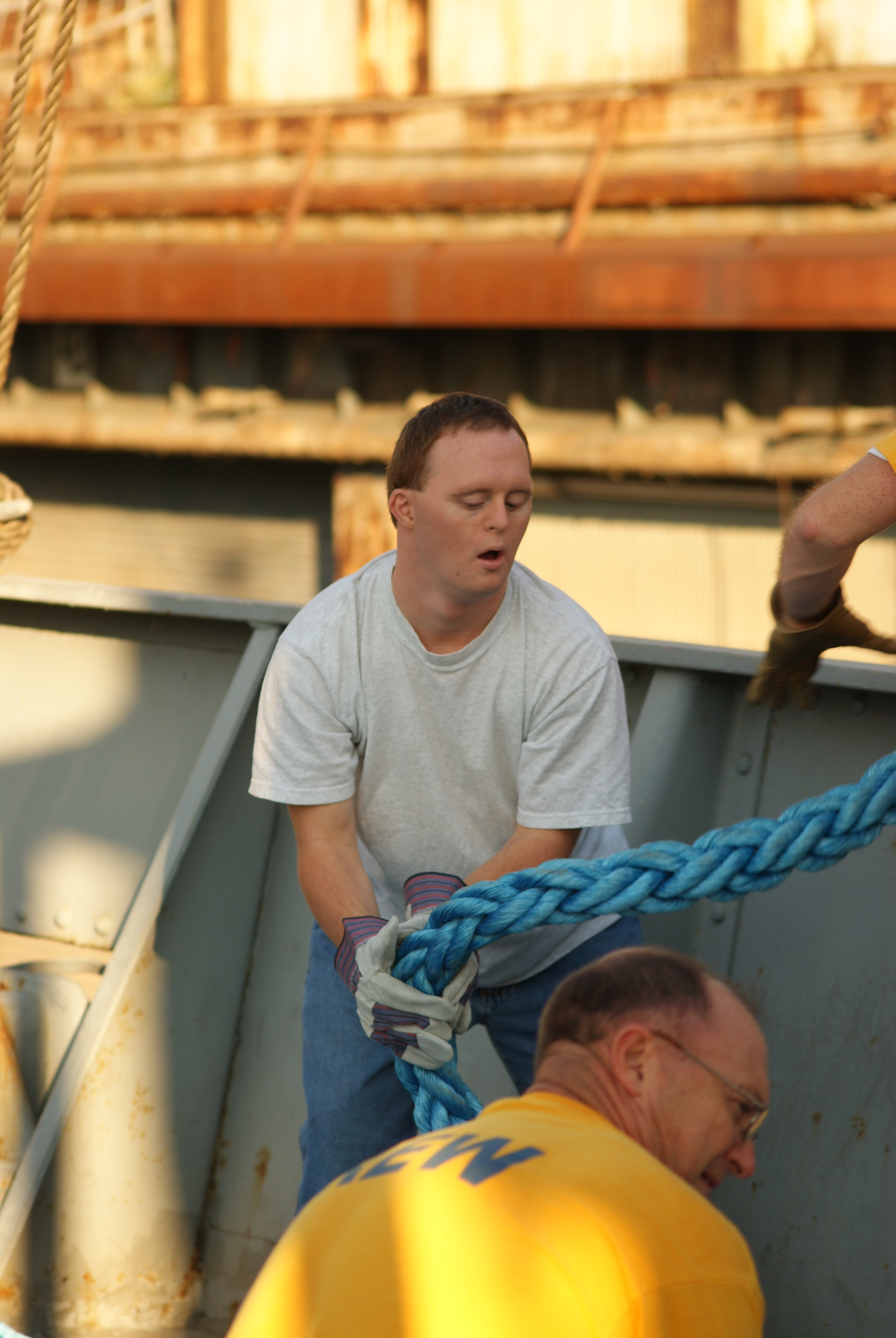 Howard (foreground) and his son Andrew (background) handling mooring lines while tying up the ship.