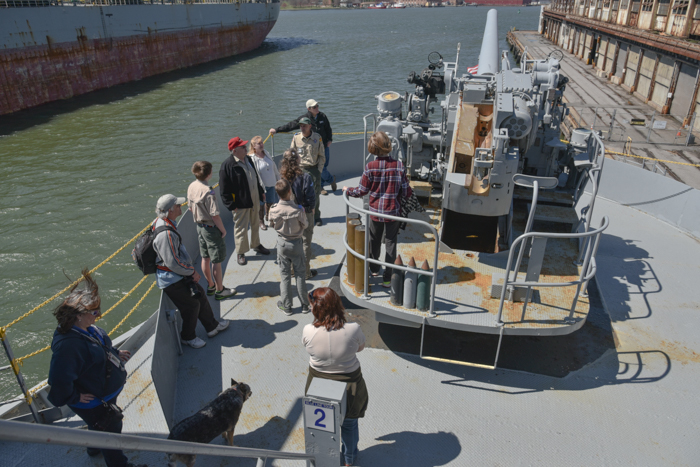 The tour moved aft and Howardtalked about differences between merchant mariners and the Armed Guard. He also explained how loading and aiming the guns changed over the course of the war.
