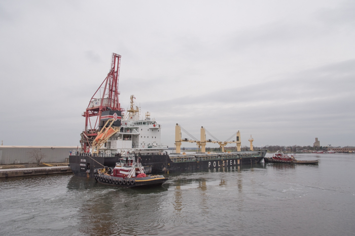 The tugs will bring the very full freighters into berth.
