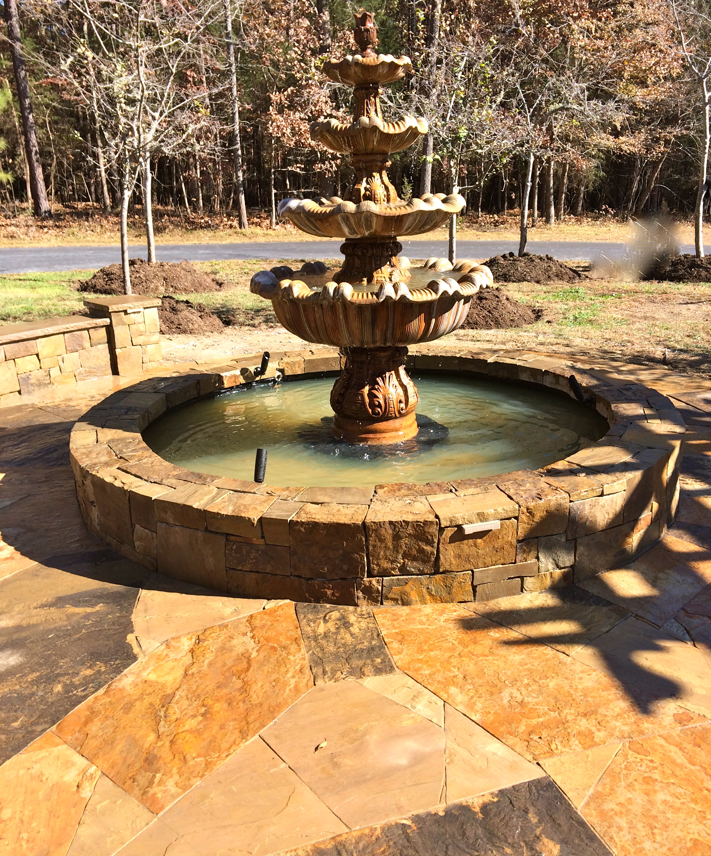 Stone fountain basin and dry laid patio