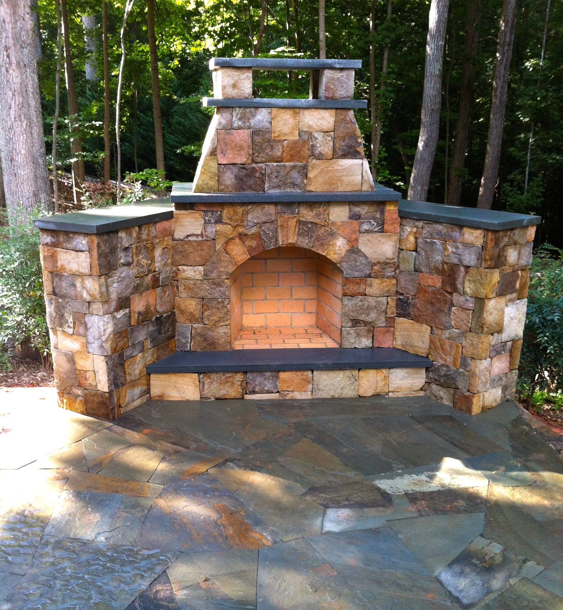 Natural stone fireplace with bluestone caps