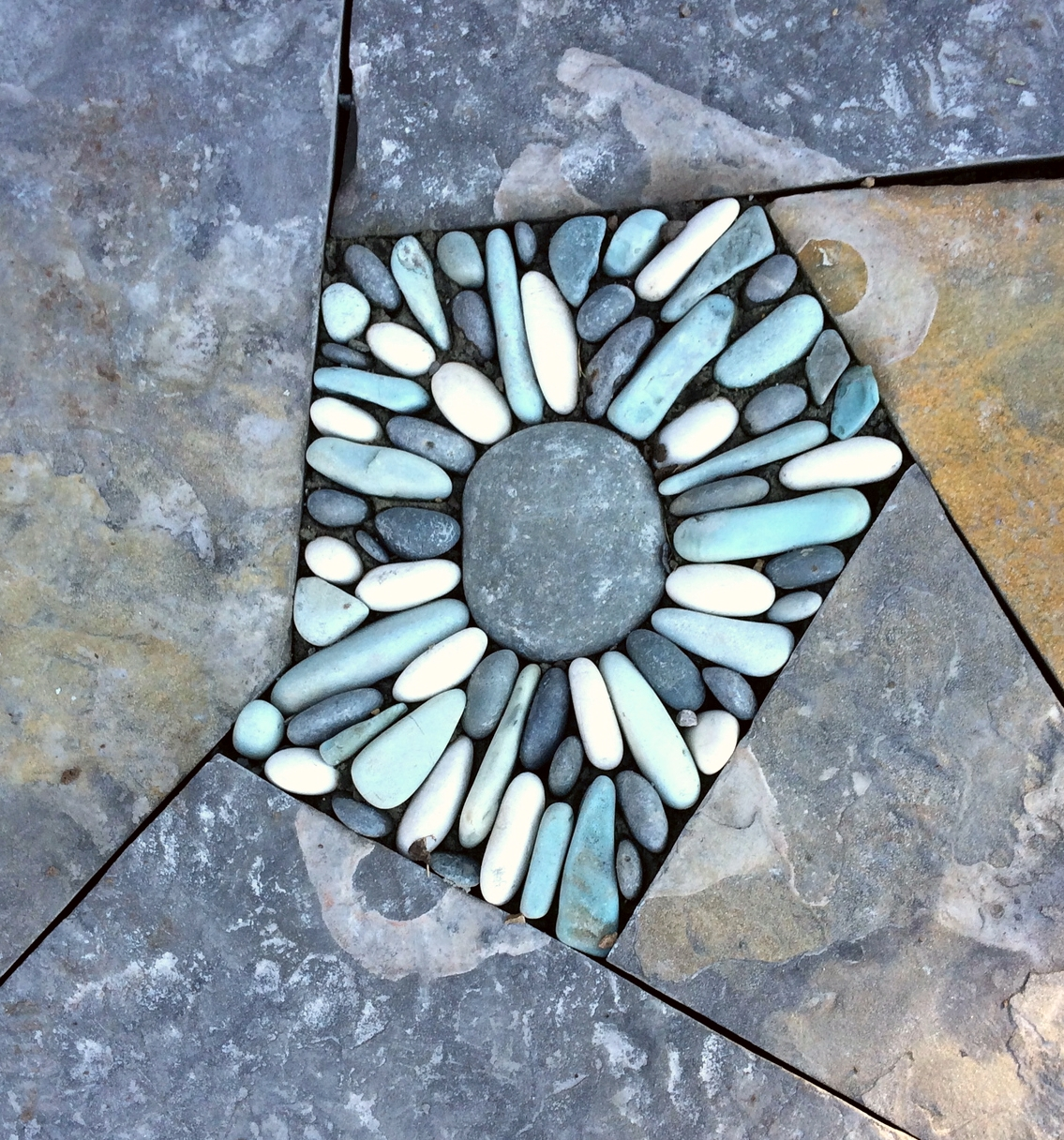 pebble inlay in a dry laid flagstone walk