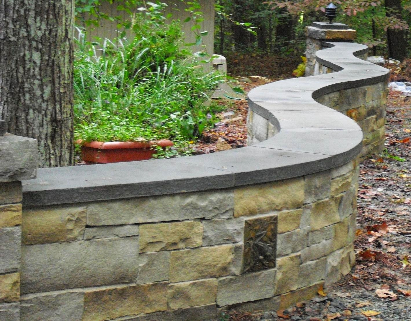 Tennessee ashlar wall with docorative tiles and bluestone cap