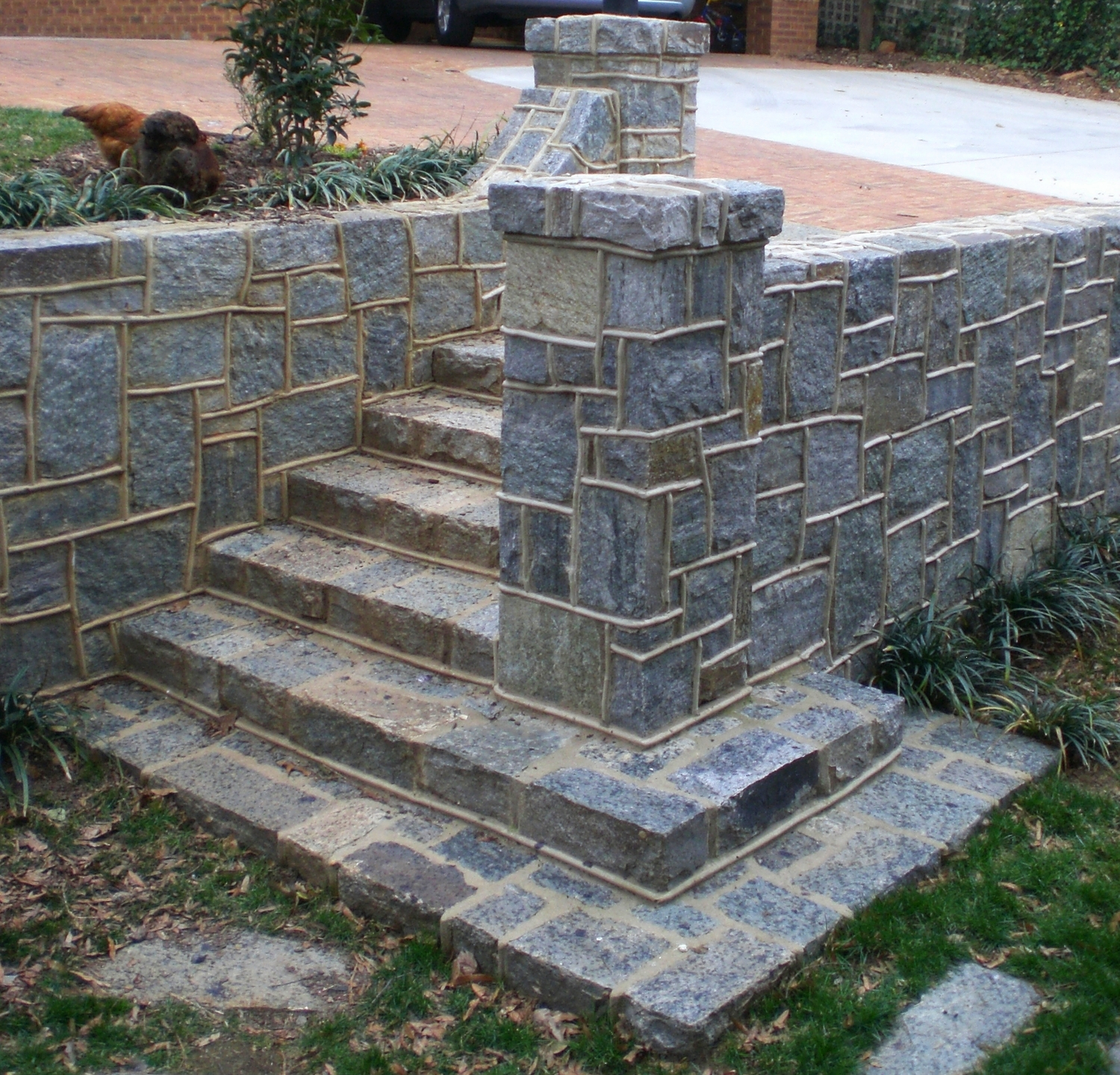 Quarried granite wall and steps with round ribbon joint