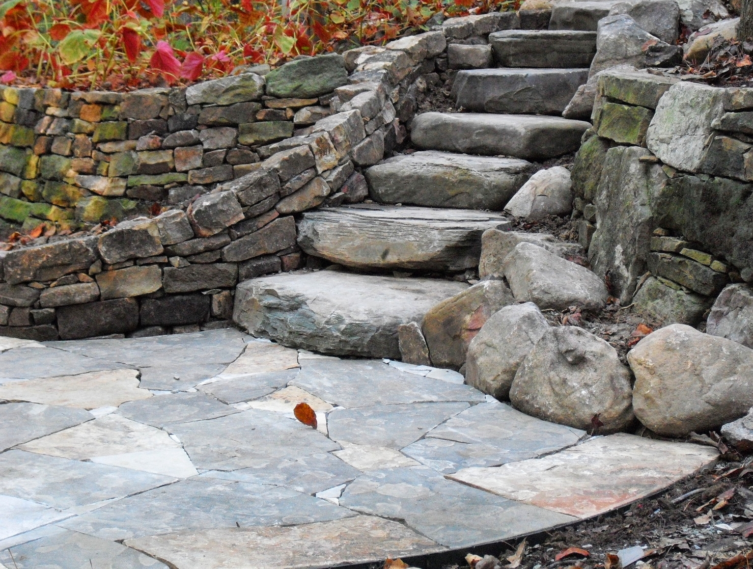Rustic steps and dry laid walls and patio