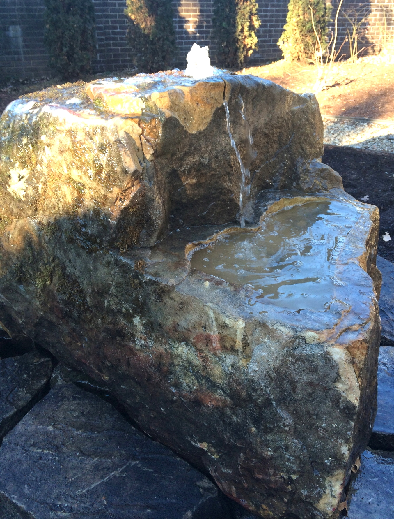 Sculpted boulder fountain install (sculpted by the Stone Center Of Carolina)