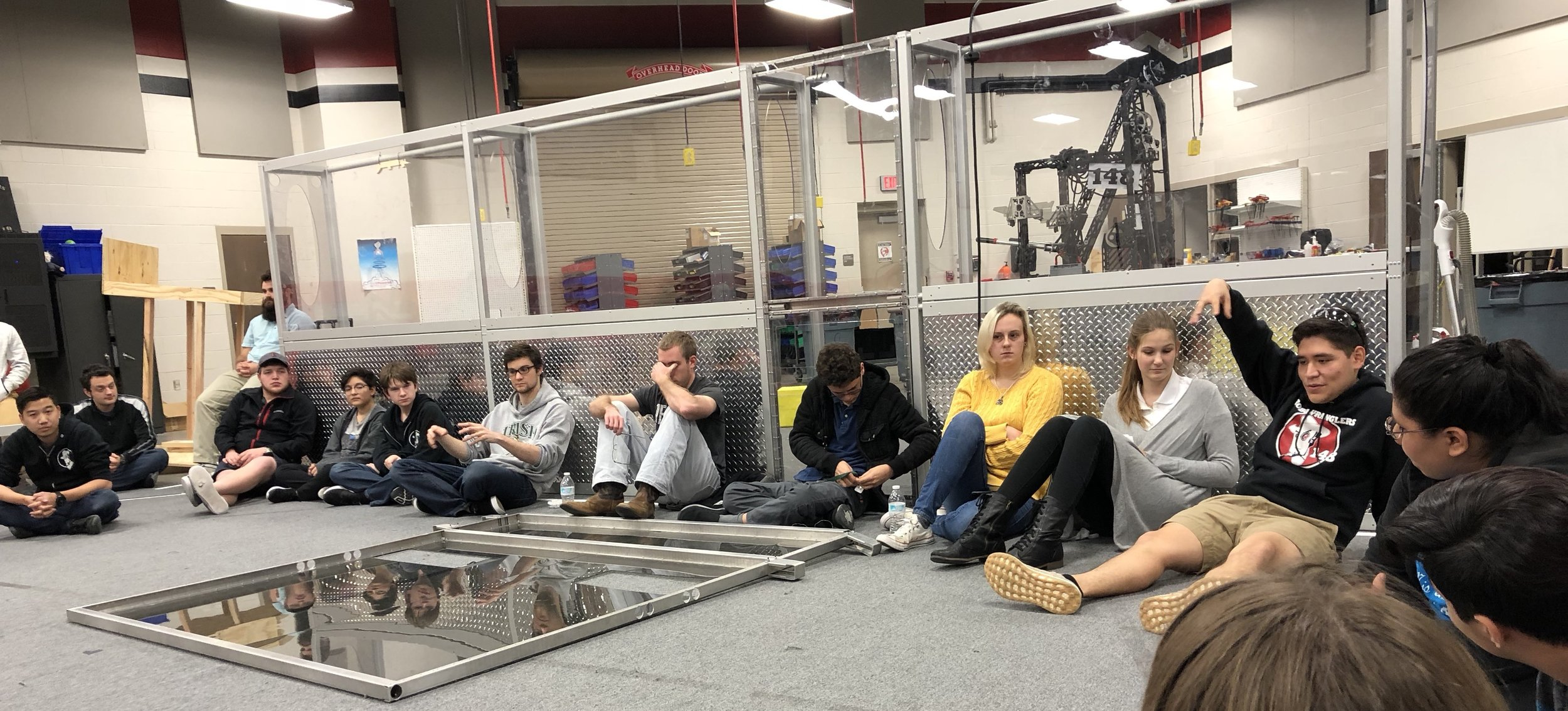 """We should build  TWO ROBOTS  connected by tether and each of them helps their own fridge. Mic Drop."" - Carlos ""I don't know what to do with my hands right now."" - BJC ""I don't know why I joined this team"" - Alex <face-palm>"