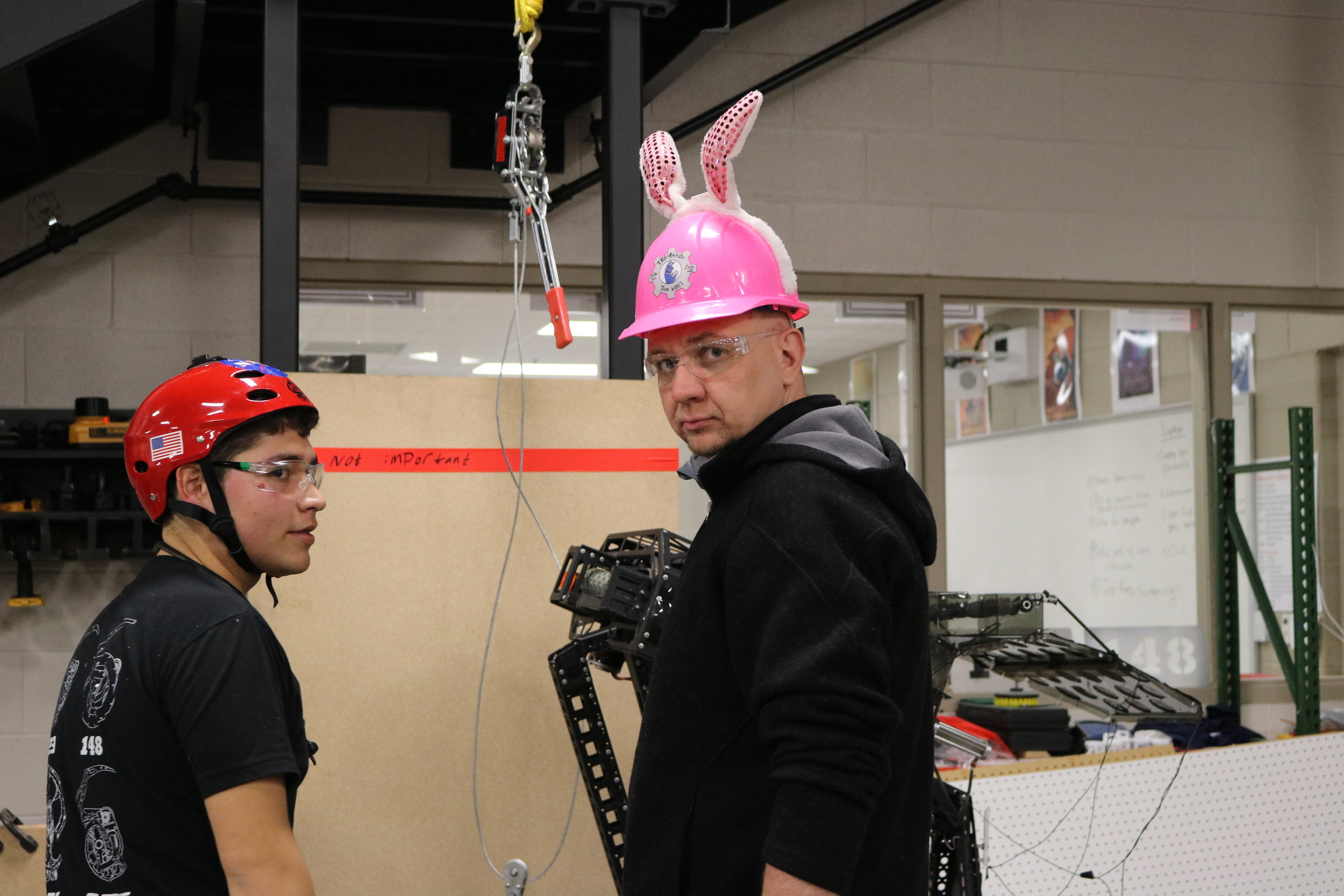 "We have some ""prototyping helmets"" that we keep in the shop for good luck.  Here I'm seen wearing my ""bunny helmet"" (Thanks 4063!) and Carlos is wearing my ""space helmet"" (Thanks 118!)  We take helmet safety very seriously on the Robowranglers. ATGATT!"