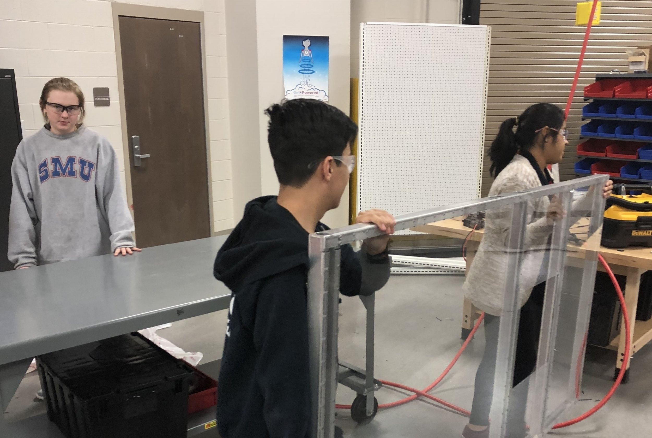 Fran, Noah, and Faith working on the game-specific field panels ready to install in our arena perimeter.  We're getting closer to a functional playing-field!  Right now the prototyping teams have everything they need, but at some point we'll have a full field ready for practice and scrimmages.
