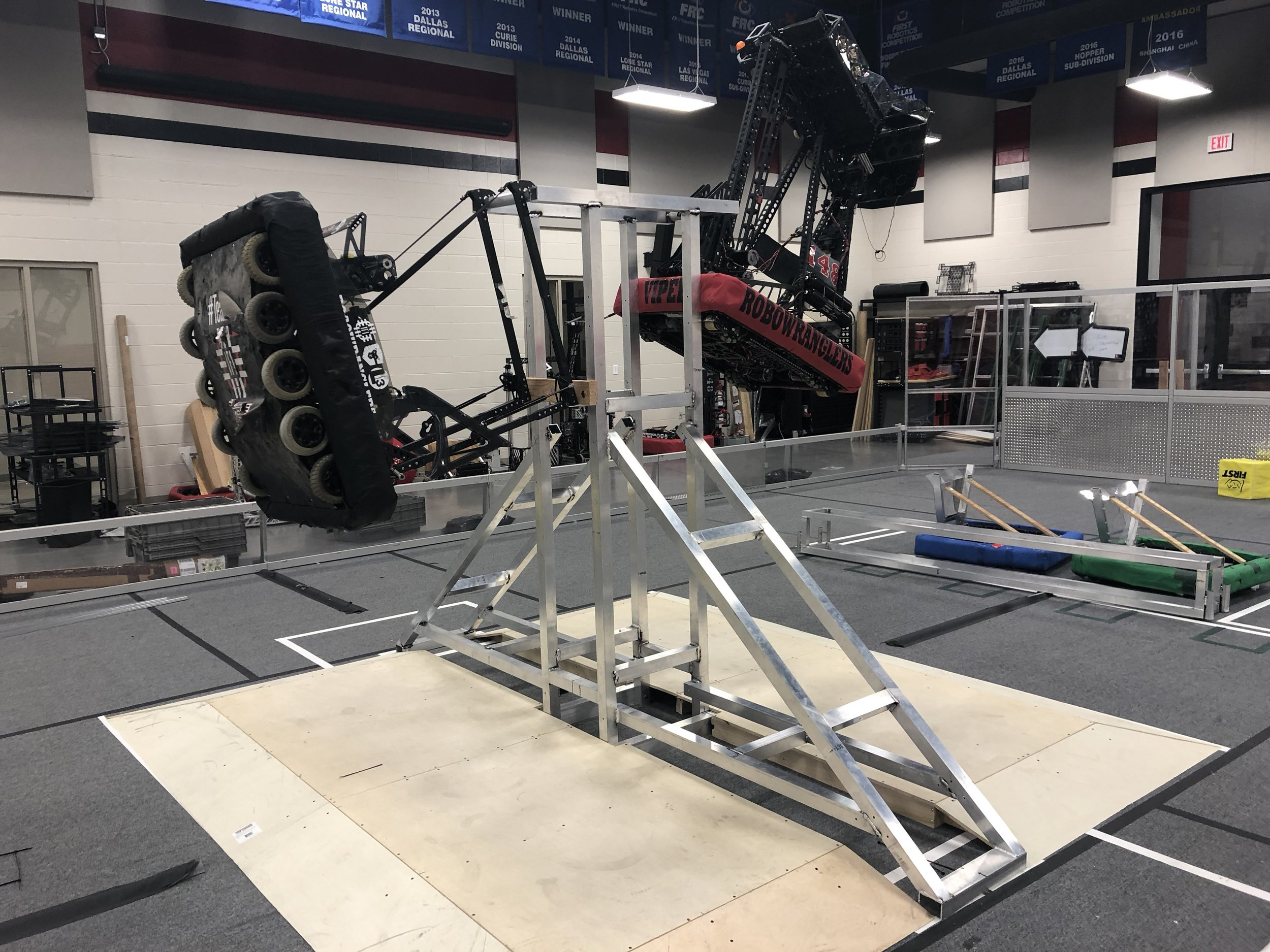 """This bar reserved for Einstein Robots ONLY"" - Our two favorite "" fallers "" hanging around showing everyone they still know how to party.  Does the 2018 Robowrangler machine share some climber-DNA with one of these bad boys?"