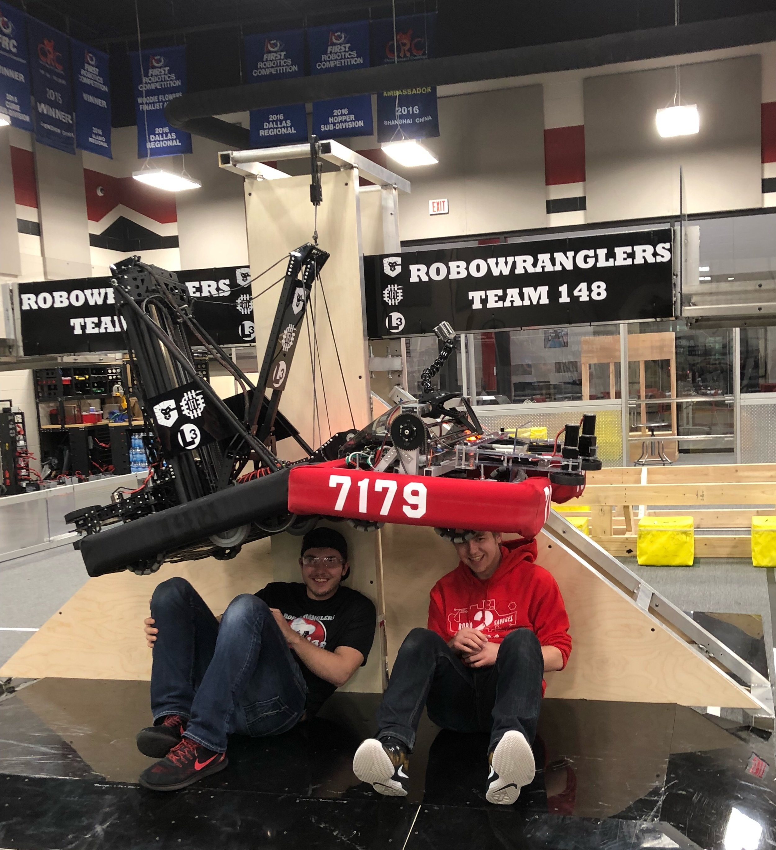 "Sam & Coleman pose for a picture in our shop after the first ever Robot Wrangler ""Buddy Climb"".  Seeing them as the first climb on the ""real"" field made it even more special."