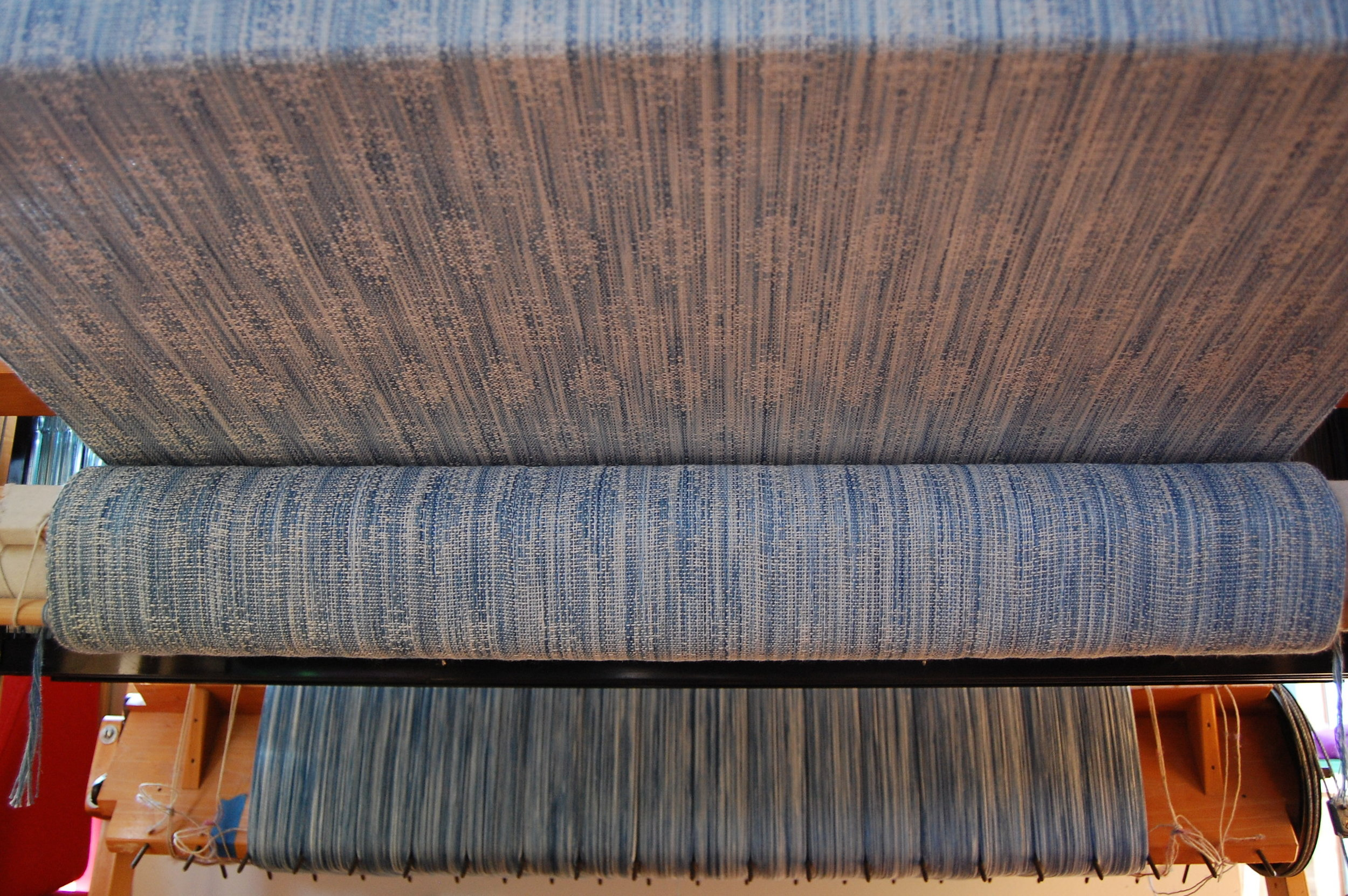 Indigo v.2 Blueprint with natural silk/seacell weft 4.7 meters - shown here during weaving
