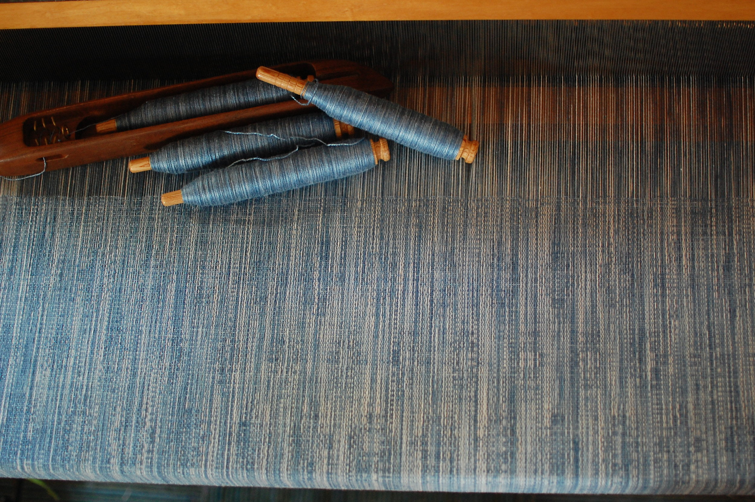 Indigo v.2 Blueprint with indigo-dyed silk/seacell weft 5.0 meters - shown here during weaving