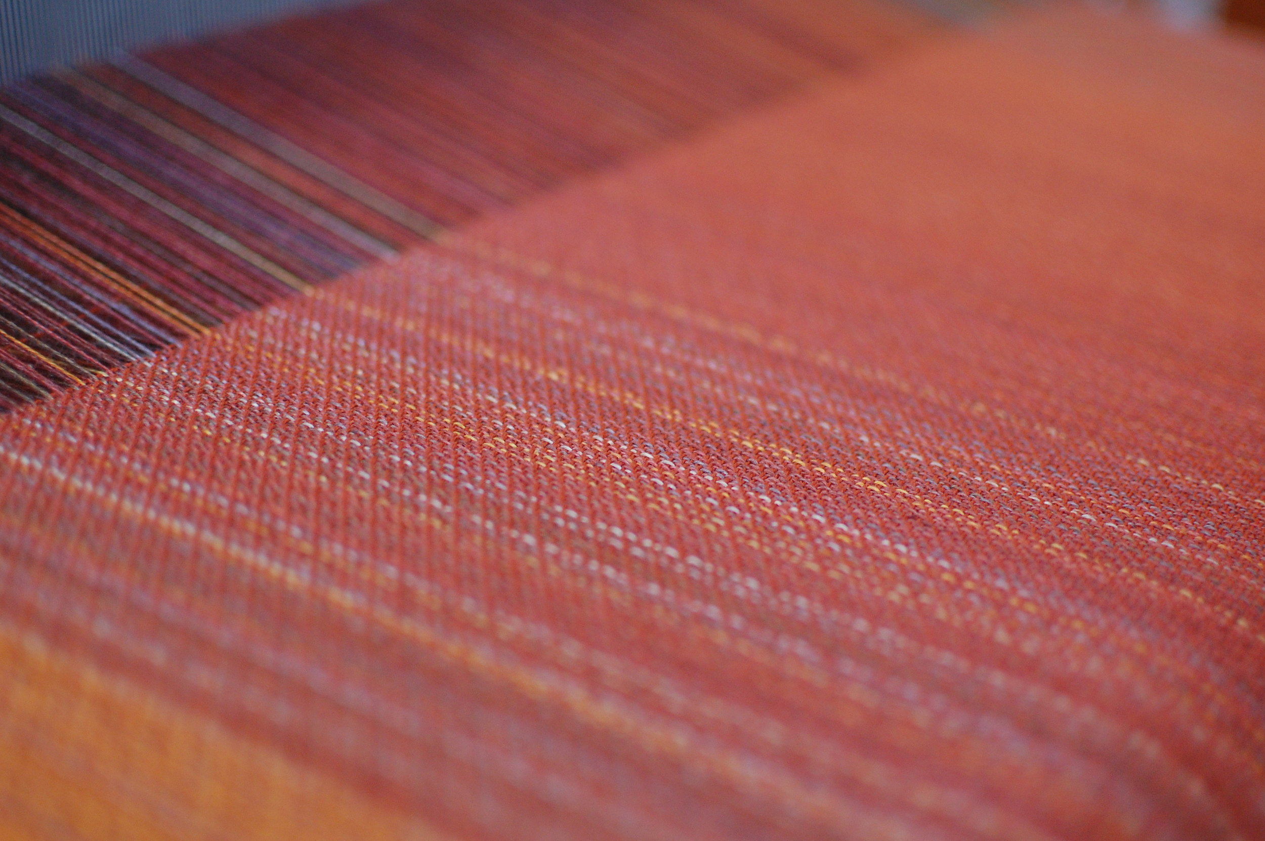 The weave - shown here with rust orange cotton weft