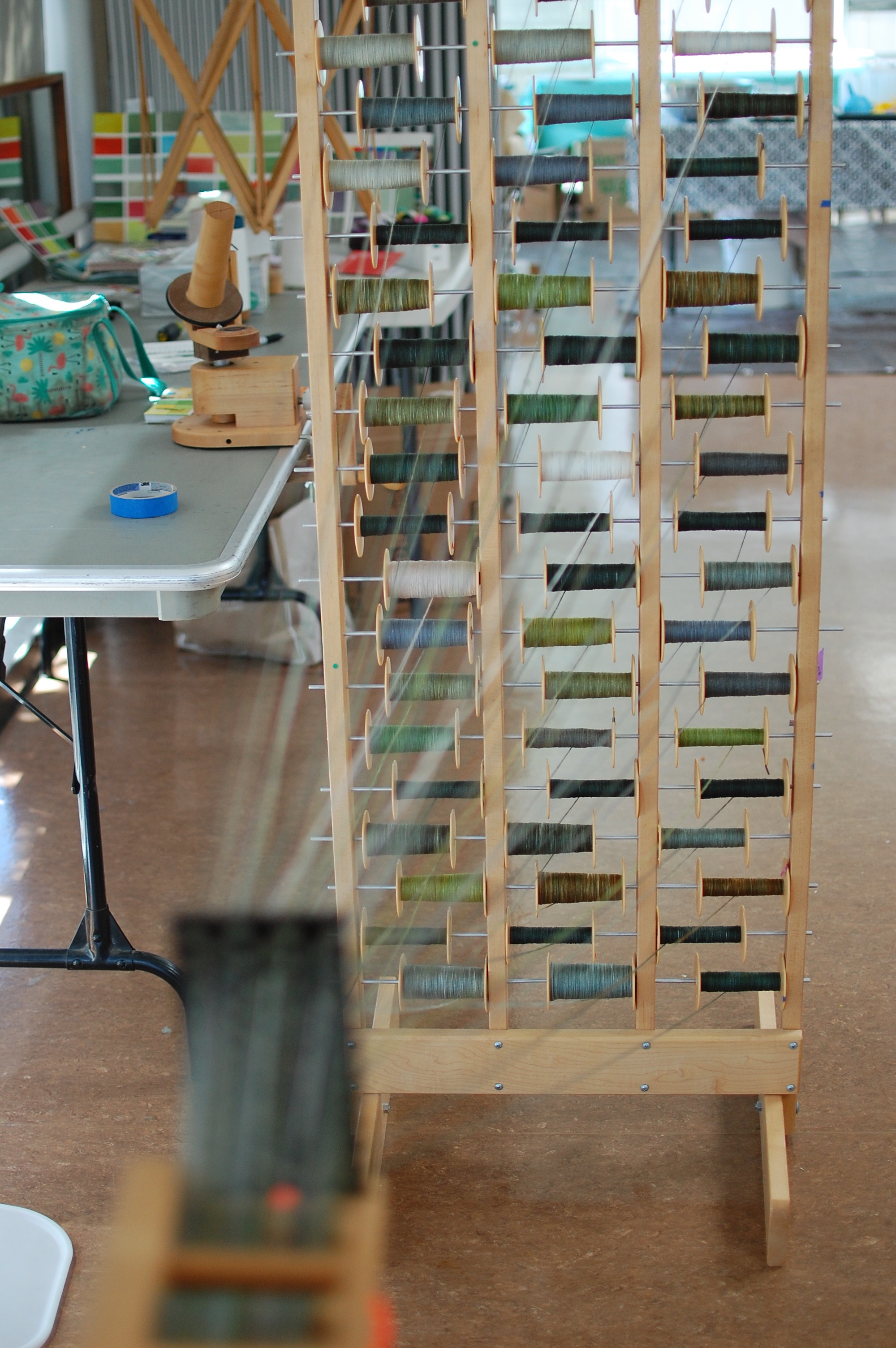 the spool rack with the yarns feeding into the section