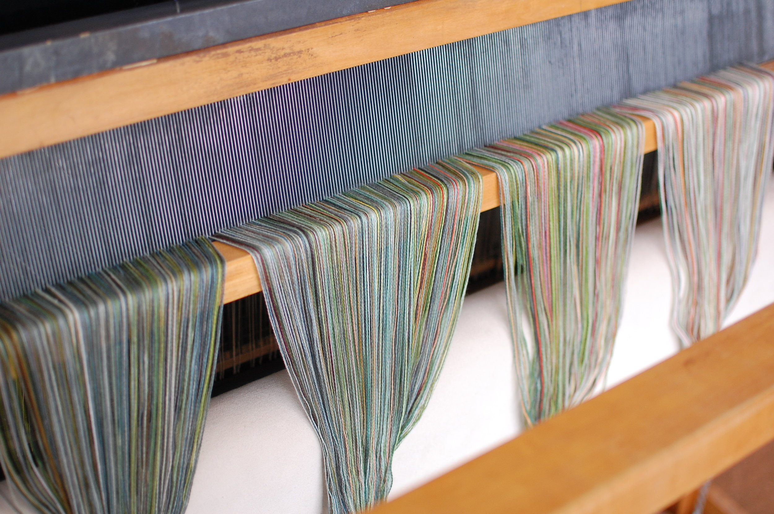 a view at the front of the loom after sleying the reed