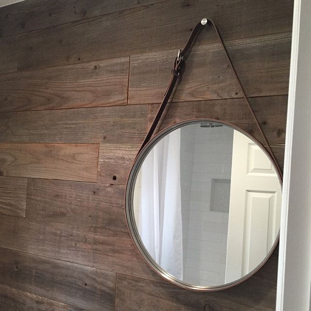 NOBI Mirror used as a bathroom vanity mirror on a beautiful wooden wall.
