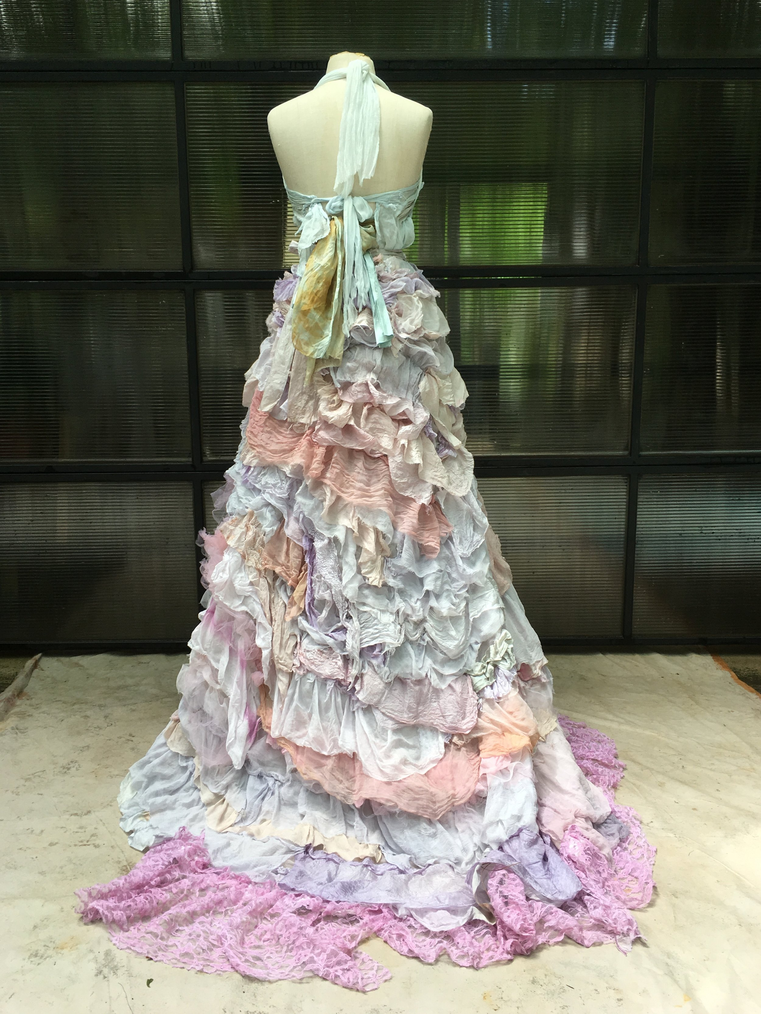 Overskirt created from preowned and vintage silks on the foundation of a vintage wedding dress.