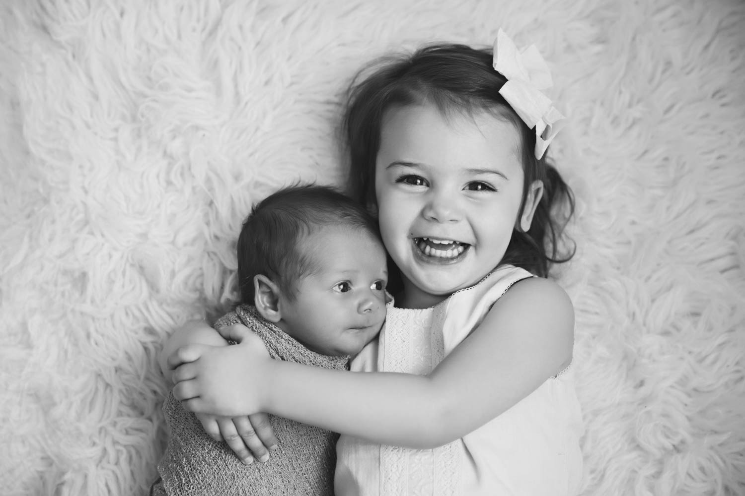 Big sister and newborn baby brother in Atlanta natural light studio