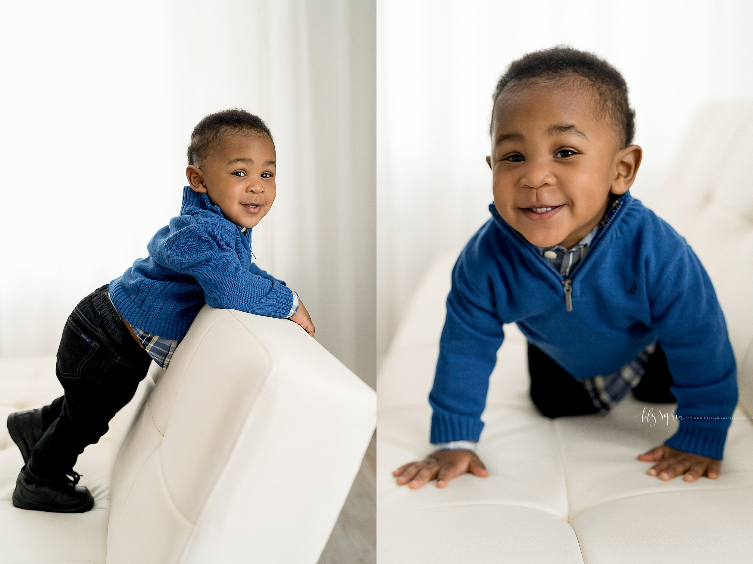Curious African American one year old stands on a white button back leather sofa in his zippered long sleeve sweater, plaid shirt, and blue jeans.  The same African American boy crawls on his hands and knees across the leather sofa in an Atlanta Studio.