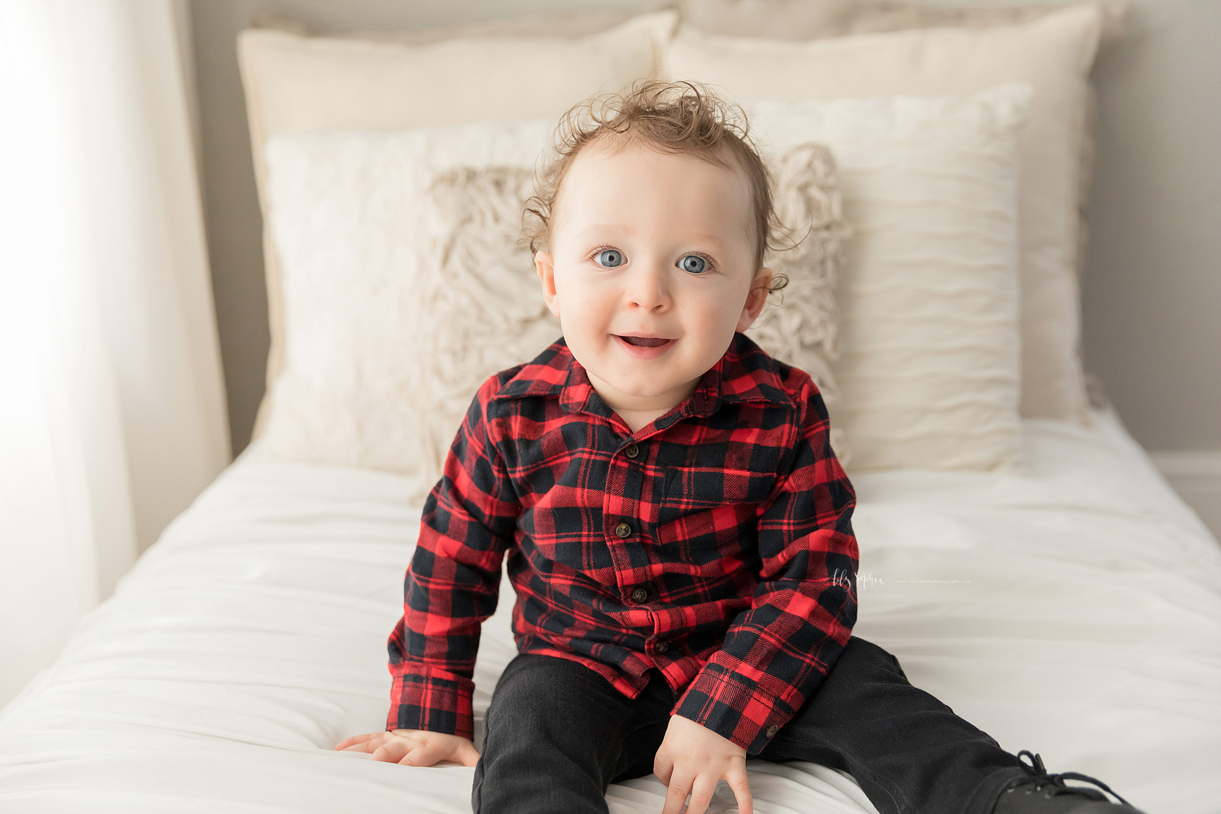 Milestone photo of a boy on his first birthday in an Atlanta natural light studio.