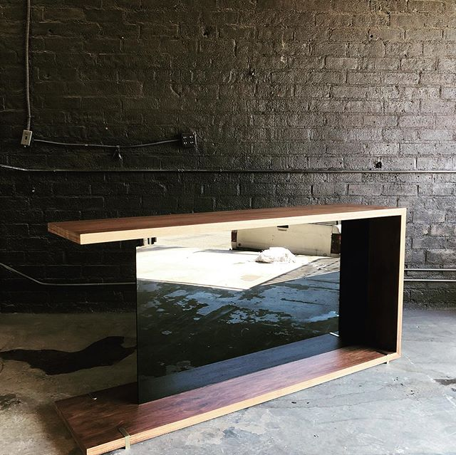 Our latest build is the Mid Century console for the soon to be JW Marriott in Anaheim. Walnut paired with smoke glass and aged brass is impossible to jank up.  Thank the goodness that we have some design chops and give these elements a vessel in which to shine.  #design #interiordesign #customfurniture #walnut #woodworking #bespoke #style #gratitude