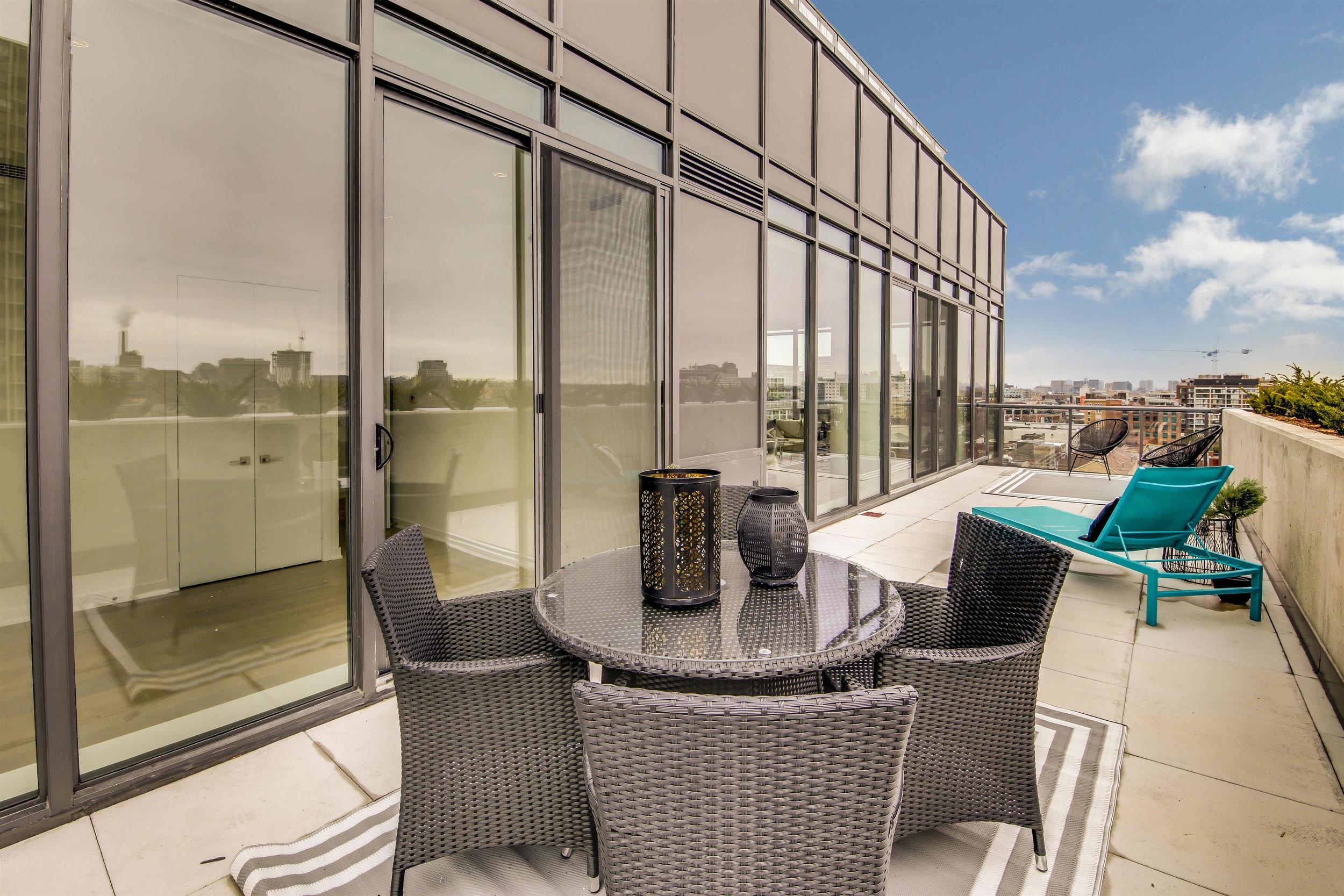 The terrace we staged at the 12 Degrees penthouse. We created spaces to eat, lounge and sit with friends.