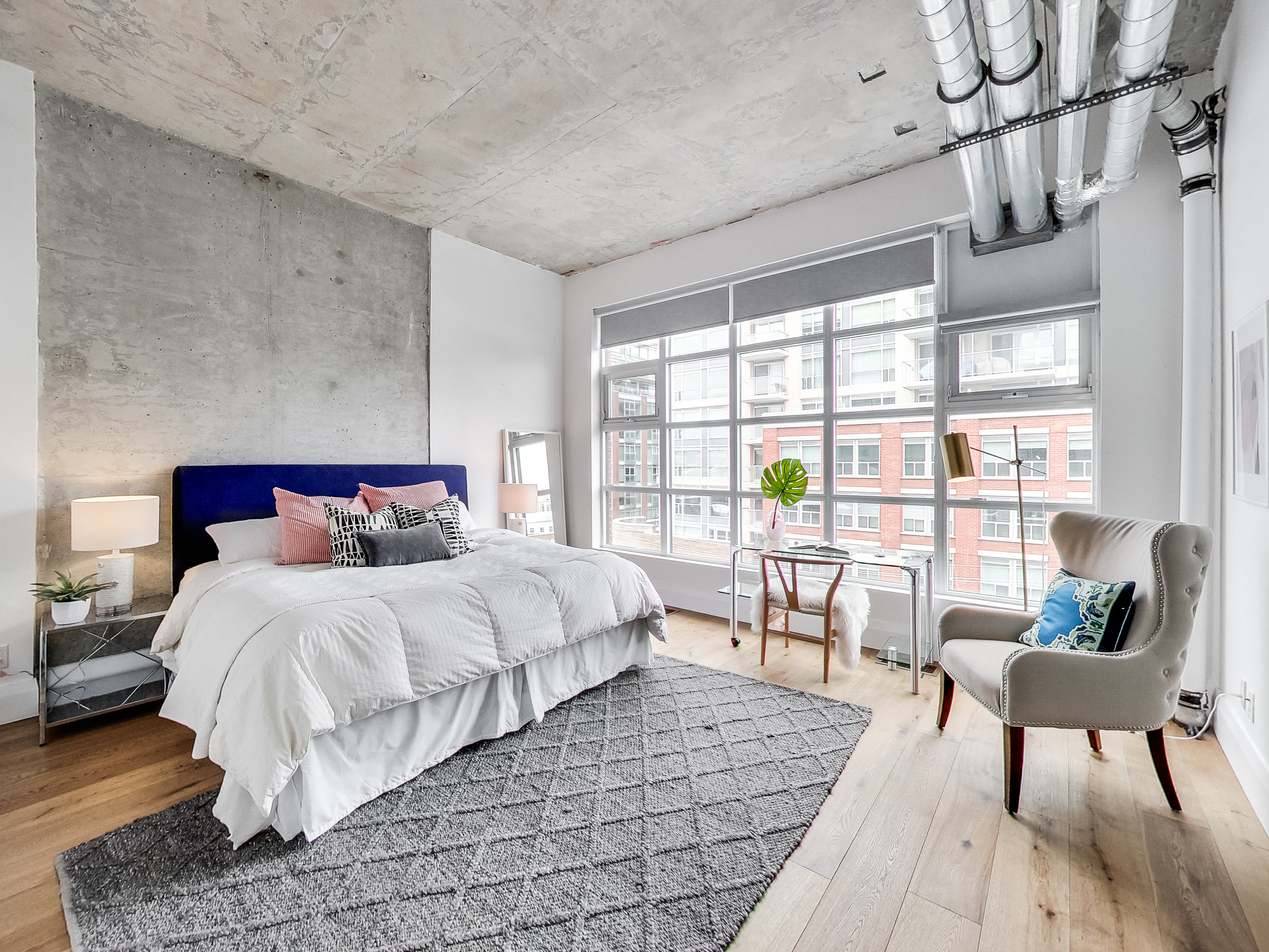 The master bedroom. I wouldn't mind waking up to this beautiful view of King Street East. There's something about old red bricked buildings that's so comforting.