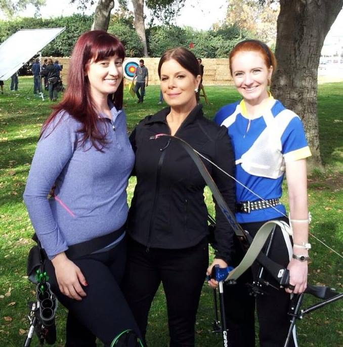 One of our archery coaches (right) and on-call archers (left) working on set