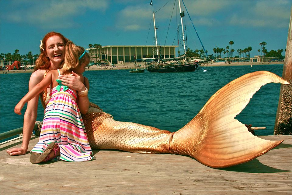 Virginia mermaid tail with child hug at ocean.jpg