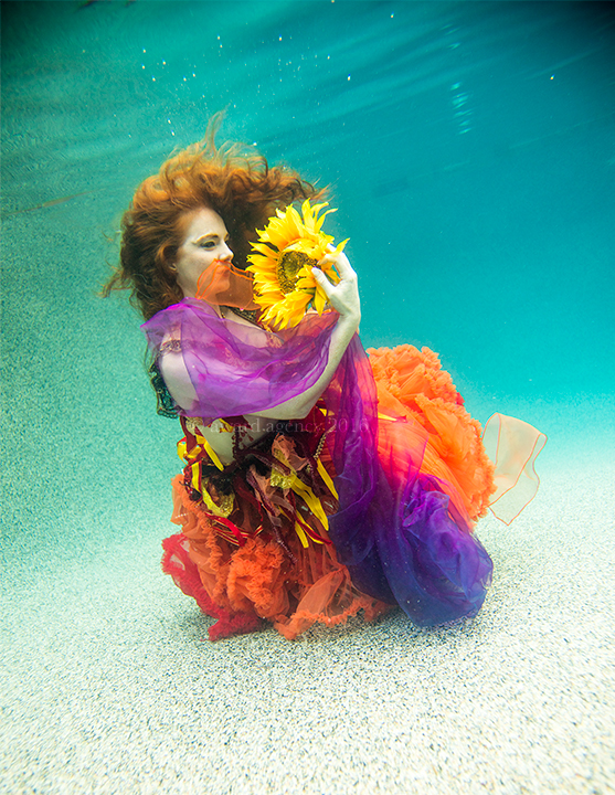 Virginia Hankins with sunflower under water by Chris Ward.jpg