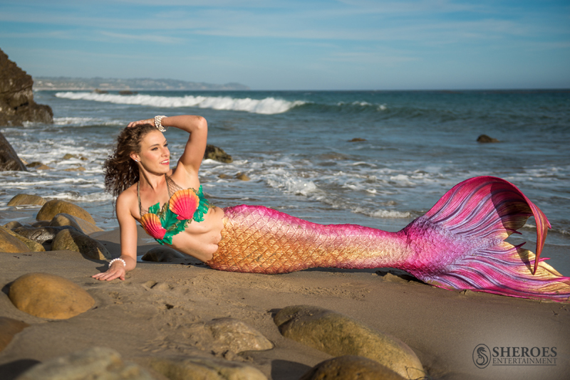 A sample of a mermaid silicone (prosthetic level) tail rental with a silicone bra top rental.