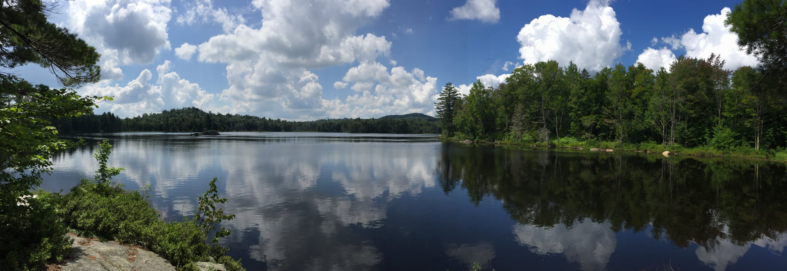 BillHahn-HighAdventure-LakeForestAndCloudsReflecting-Panorama.JPG