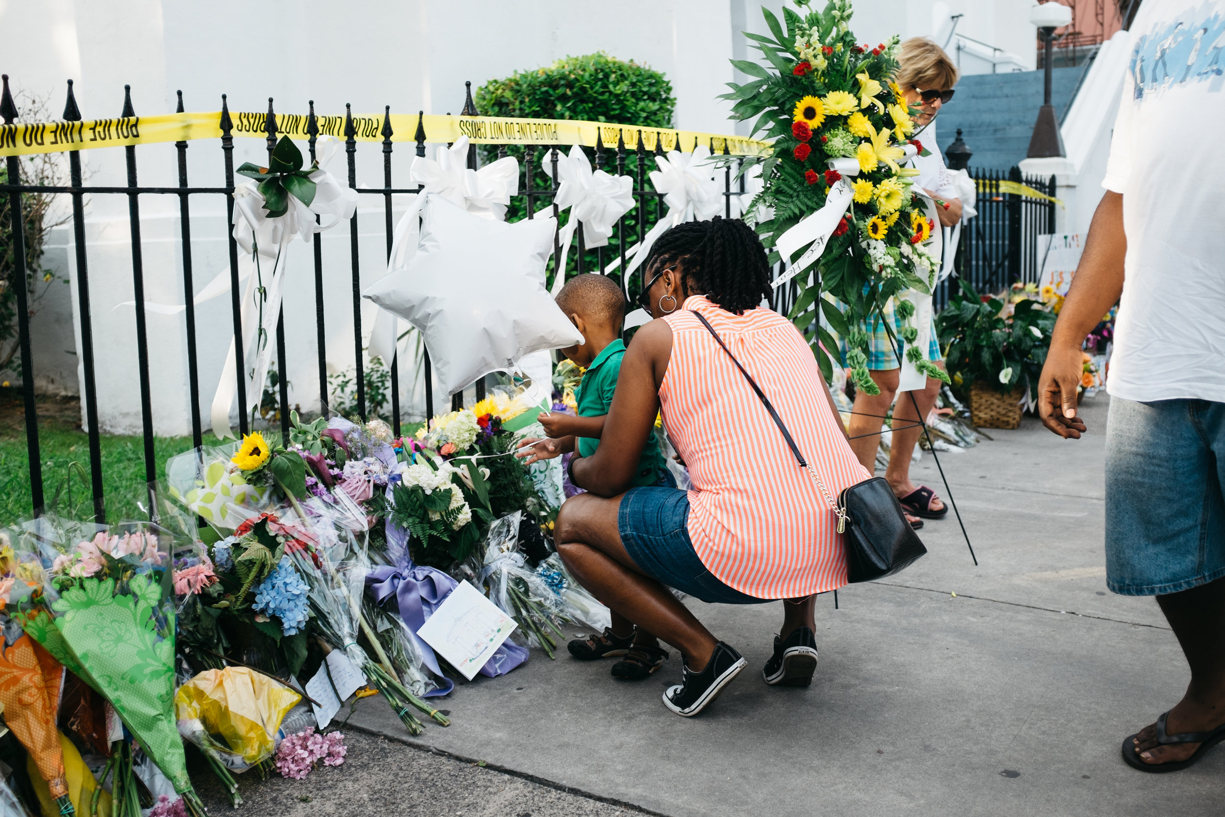 A mother and her son pay their respects to the nine victims of the Emanuel A.M.E. Church shootings on June 19, 2015, Charleston, SC.