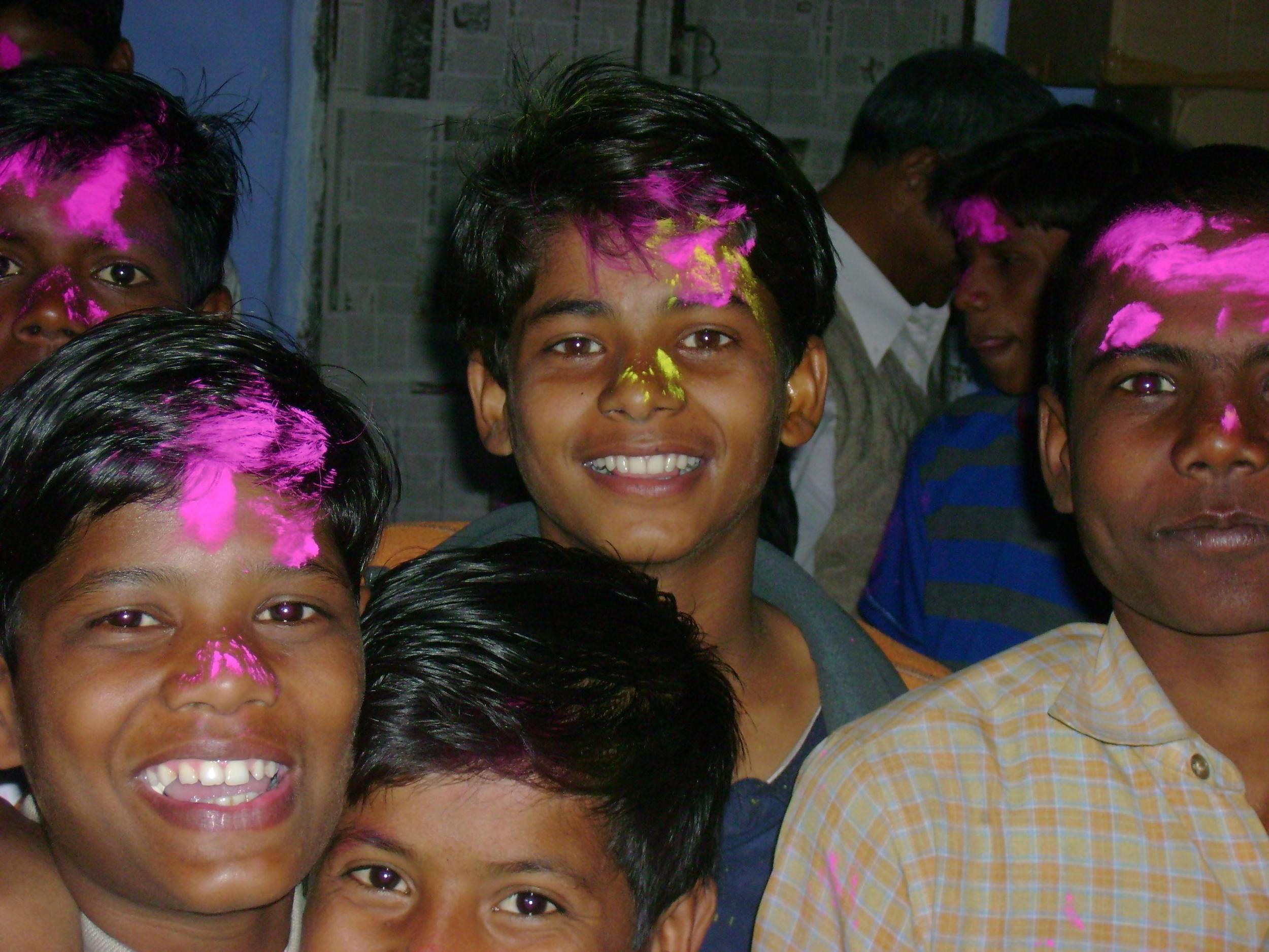 Boys from the Children of Mother Earth project celebrating the festival of Holi.