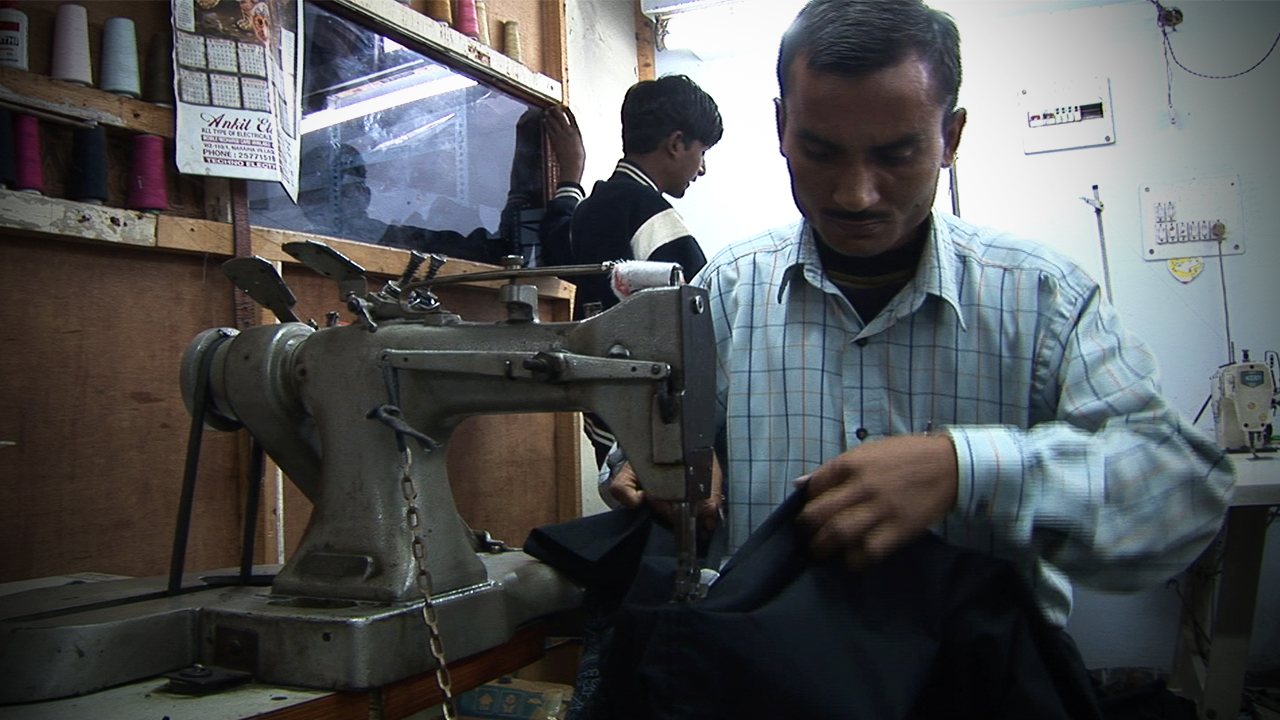 Tailoring apprenticeship. One of the many employment programmes run by COME for young adults
