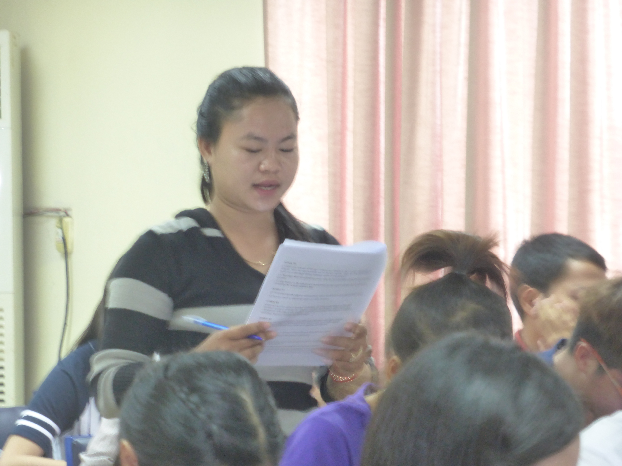 A student reads part of the the Universal Declaration of Human Rights aloud to her classmates.