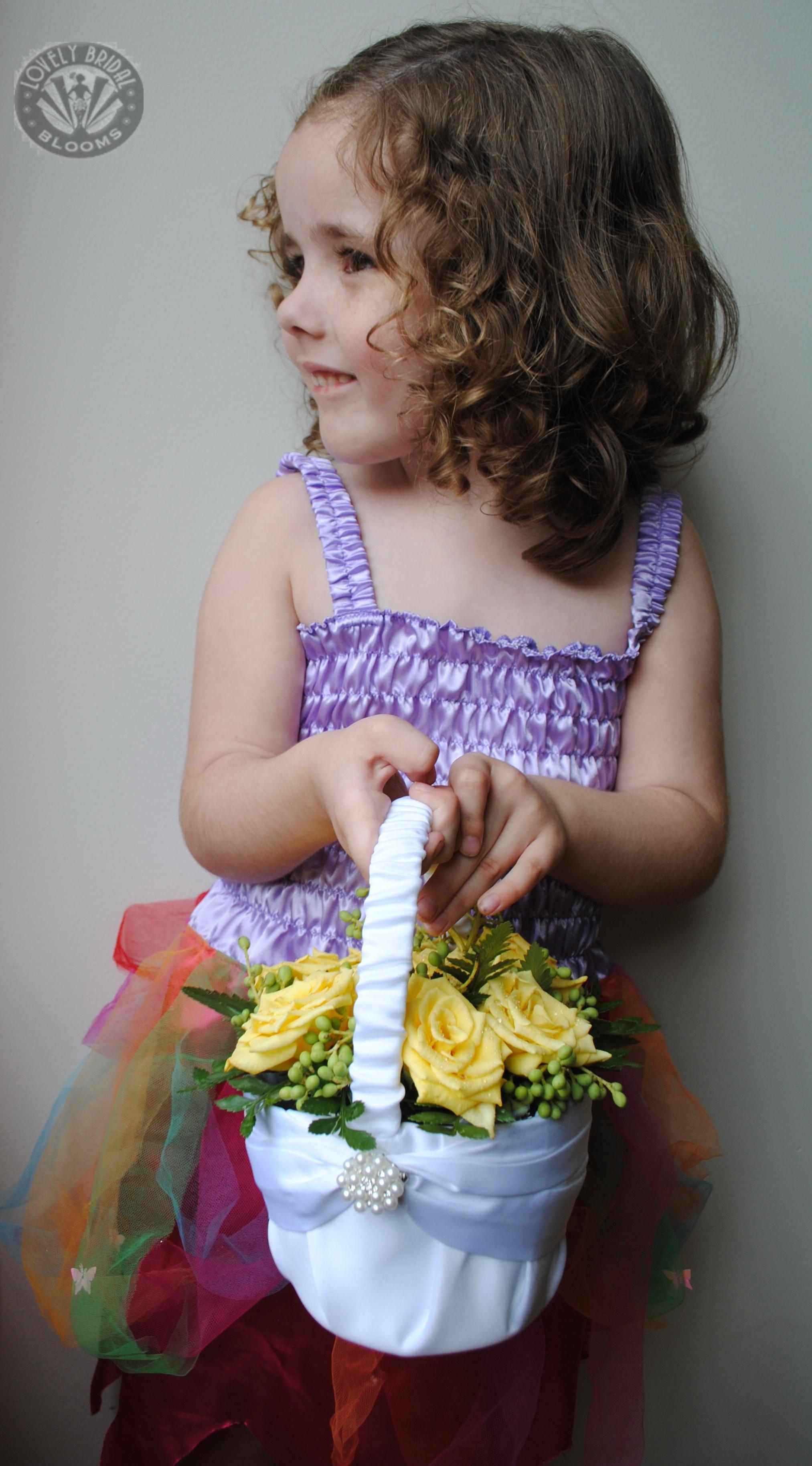 flowergirl satin basket arrangement.jpg