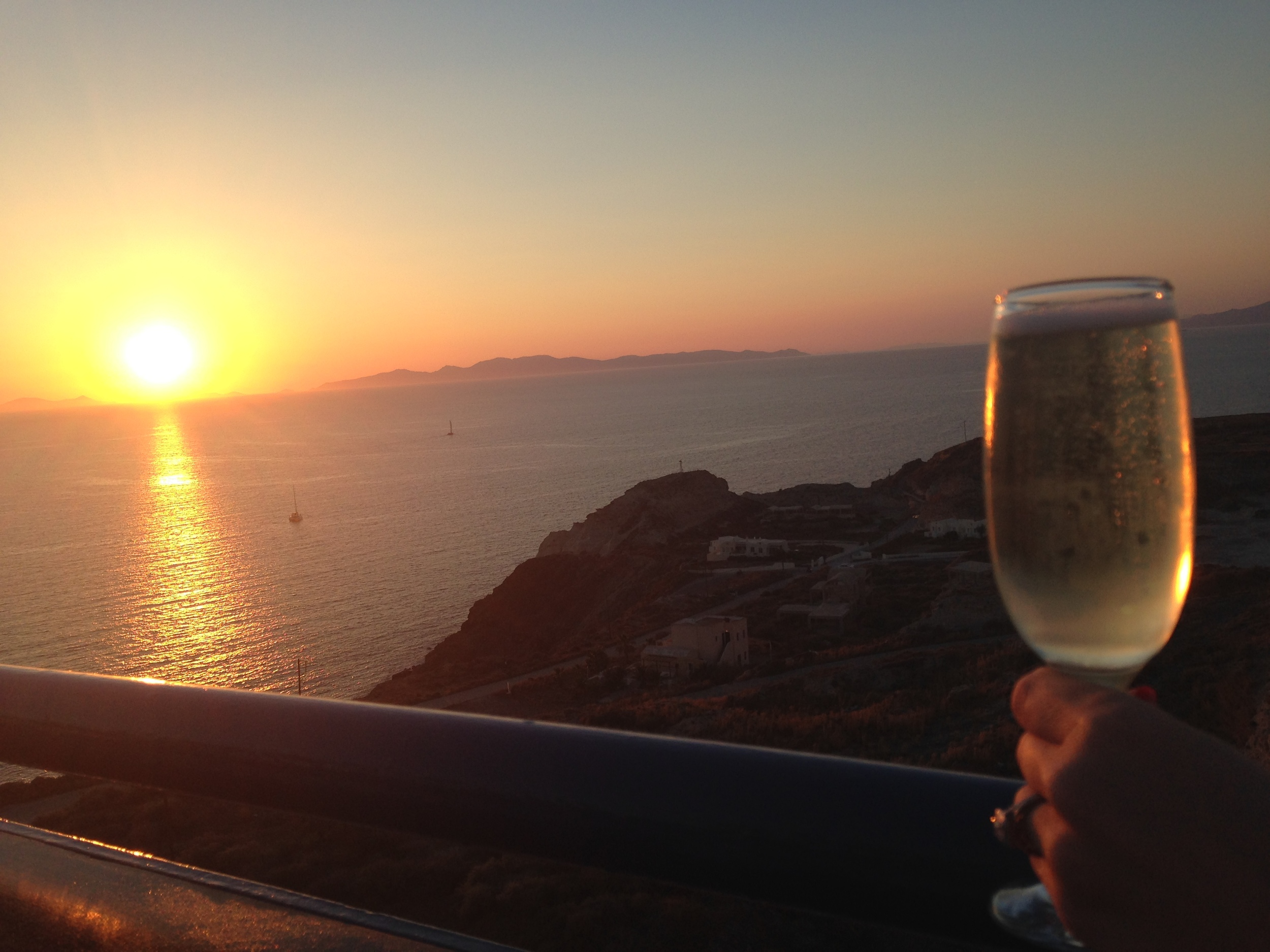 Enjoy the sunset in Oia, the northern point of the island of Santorini