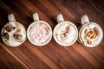 Hudson's Lodge signature hot cocoas include toppings such as burnt marshmallow,  crushed candy cane,  cookie dough and pretzels.