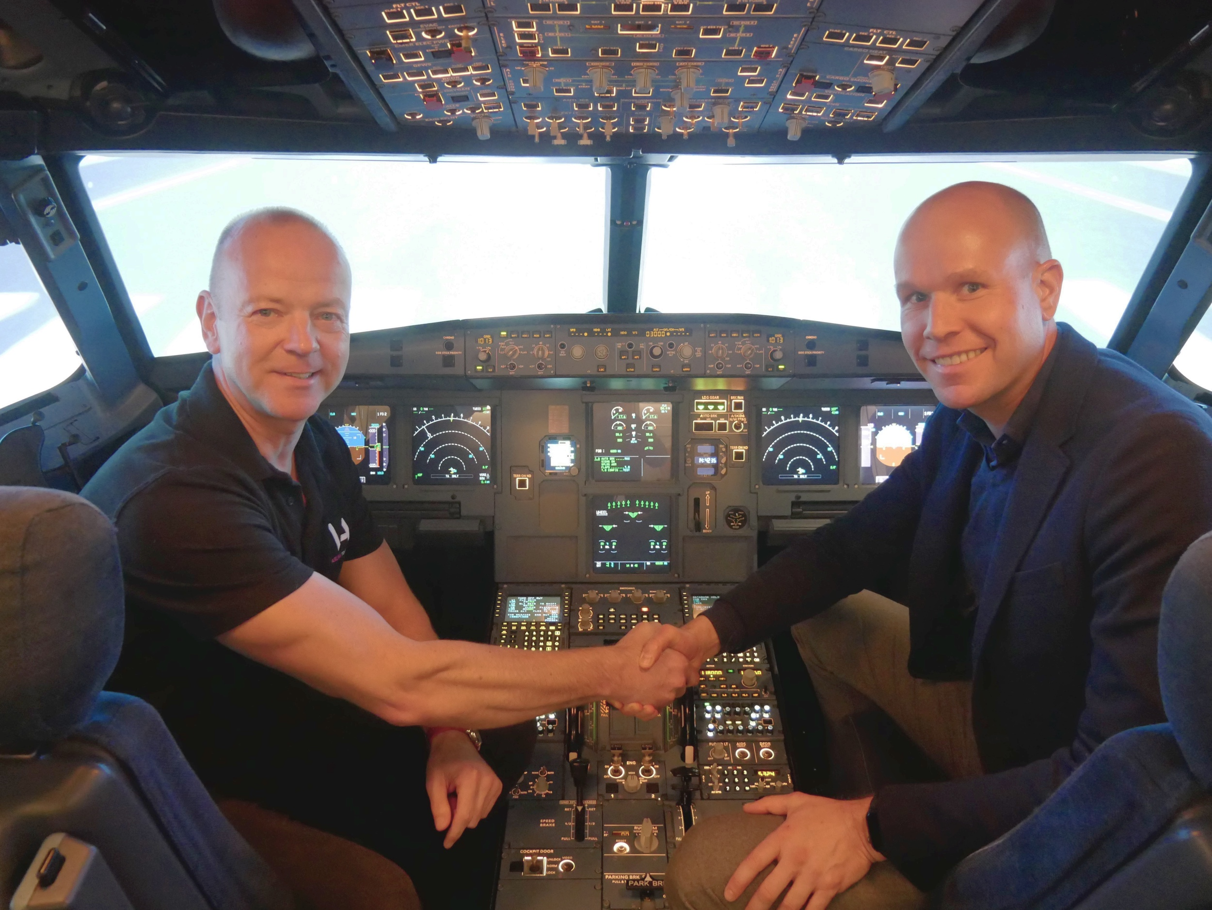 Anthony Petteford, Executive Director of VA Airline Training and Carst Lindeboom of MPS, pictured during the official handover of VA Airline Training's first A320ceo simulator at Cambridge Airport on 5 March 2019.