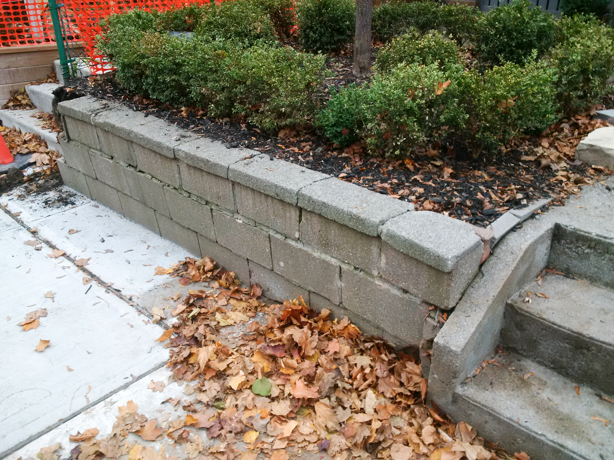 BEFORE: out of date cinder blocks created an eye sore.