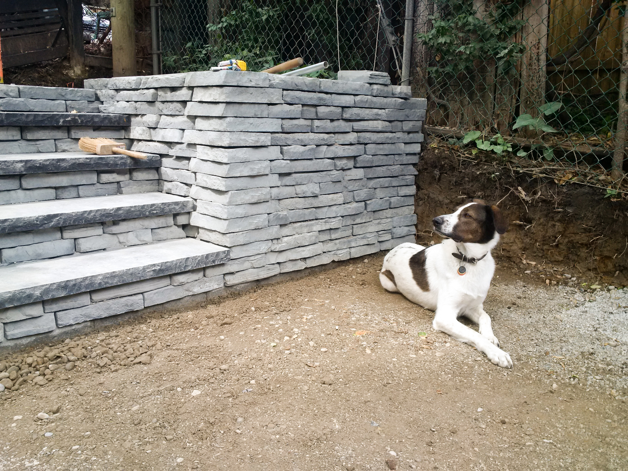 Supervisor inspecting the new wall