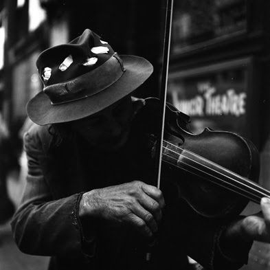 "Life is like playing a violin in public and learning the instrument as one goes on.""  Samuel Butler    Photograph by Henri Carter-Bresson"